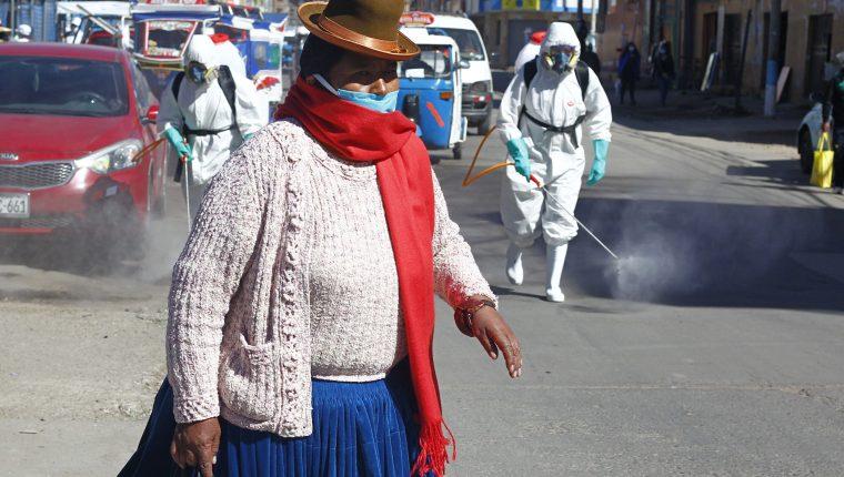 Los habitantes de las alturas andinas de Bolivia y Perú han resistido mejor el nuevo coronavirus. que sus compatriotas de las tierras bajas, lo que ha llamado la atención de los expertos. (Foto Prensa Libre: AFP)