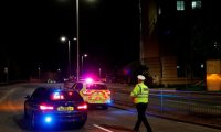 """Police officers are seen at a police cordon in central Reading, west of London, on June 20, 2020 following a stabbing incident at Forbury Gardens park. - British police said Saturday they were investigating a """"serious incident"""" in the southern English city of Reading, with reports suggesting multiple stabbings. British media said the stabbings occurred in a central park, requiring two air ambulances to be called in. (Photo by Adrian DENNIS / AFP)"""