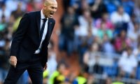(FILES) In this file photo taken on October 01, 2019 Real Madrid's French coach Zinedine Zidane shouts intructions to his players during the UEFA Champions league Group A football match between Real Madrid and Club Brugge at the Santiago Bernabeu stadium in Madrid on October 1, 2019. - Two points separate Spain's greatest rivals FC Barcelona and Real Madrid CF ahead of the return to top-flight games on June 11, 2020, when the derby between Sevilla and Real Betis will end a 93-day hiatus and launch a five-week sprint to the finish. (Photo by OSCAR DEL POZO / AFP)