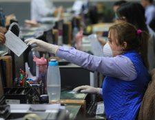 Los protocolos y disposiciones establecen nuevas medidas y obligaciones de empleadores y trabajadores.  (Foto, Prensa Libre: Hemeroteca PL).