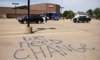 MINNEAPOLIS, MN - JULY 08: Graffiti is written in the parking lot of a US Bank branch on July 8, 2020 in Minneapolis, Minnesota. The branch was damaged during the unrest after the killing of George Floyd. A temporary mobile bank has been set up in the parking lot to offer an interim solution while the branch is repaired.   Stephen Maturen/Getty Images/AFP == FOR NEWSPAPERS, INTERNET, TELCOS & TELEVISION USE ONLY ==
