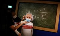 Bangkok (Thailand), 13/07/2020.- A staff member puts a mask on a wax statue of theoretical physicist Albert Einstein at the Madame Tussauds Museum in Bangkok, Thailand, 13 July 2020. According to local media reports, Thailand is expected to produce a vaccine for COVID19 by the third quarter of 2021. The first phase of human trials will begin in October 2020 with over 10,000 participants between Thai nationals and foreigners, Thai Professor of Chula Vaccine Research Center, Kiat Ruxrungtham said. (Tailandia) EFE/EPA/NARONG SANGNAK
