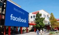 (FILES) In this file photo taken on October 23, 2019 A giant digital sign is seen at Facebook's corporate headquarters campus in Menlo Park, California. - Several US firms have joined a call by activists to halt ad spending on Facebook over concerns the leading social network has fallen short in efforts to crack down on hate speech and incitements to violence. The sporting goods maker Patagonia added its name to the list on June 21, 2020, joining rivals North Face and REI and the freelance staffing agency Upwork. (Photo by Josh Edelson / AFP)