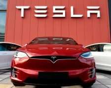 (FILES) In this file photo the logo marks the showroom and service center for the US automotive and energy company Tesla in Amsterdam on October 23, 2019. - US electric car maker Tesla on July 1, 2020 became the world's most valuable auto company by market value, surpassing Japan's Toyota after earlier overtaking conventional Detroit giants.Tesla's value reached $207.2 billion, according to Bloomberg, compared with Toyota's value of $201.9 billion. (Photo by JOHN THYS / AFP)