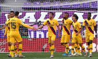 Barcelona players celebrate their goal, scored by Barcelona's Chilean midfielder Arturo Vidal (4R) during the Spanish league football match between Real Valladolid FC and FC Barcelona at the Jose Zorrilla stadium in Valladolid on July 11, 2020. (Photo by CESAR MANSO / AFP)