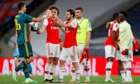 Arsenal's Argentinian goalkeeper Emiliano Martinez (L) celebrats with Arsenal's Brazilian defender David Luiz (2L) and Arsenal's Spanish midfielder Dani Ceballos (3L) at the end of the English FA Cup semi-final football match between Arsenal and Manchester City at Wembley Stadium in London, on July 18, 2020. (Photo by MATTHEW CHILDS / POOL / AFP) / NOT FOR MARKETING OR ADVERTISING USE / RESTRICTED TO EDITORIAL USE
