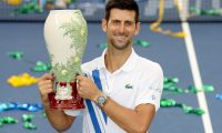 NEW YORK, NEW YORK - AUGUST 29: Novak Djokovic of Serbia poses with the winner's trophy after defeating Milos Raonic of Canada in the men's singles final of the Western & Southern Open at the USTA Billie Jean King National Tennis Center on August 29, 2020 in the Queens borough of New York City.   Matthew Stockman/Getty Images/AFP == FOR NEWSPAPERS, INTERNET, TELCOS & TELEVISION USE ONLY ==