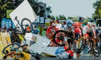 (FILES) In this file photo taken on August 5, 2020 Dutch cyclist Fabio Jakobsen's bicycle (behind,L) flies through the air as he collides with compatriot Dylan Groenewegen (on the ground ,L) during the opening stage of the Tour of Poland race in Katowice , southern Poland. - A few days before the start of the Tour de France, after the fall of Remco Evenepoel during the Tour of Lombardy and the one of Fabio Jakobsen during the Tour of Poland, the the cyclist struggle with this series of accidents which marked the resumption of the races. (Photo by Szymon Gruchalski / Forum / AFP)