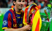 """(FILES) In this file photo taken on May 28, 2011 Barcelona's Argentinian forward Lionel Messi celebrates with the trophy at the end of the UEFA Champions League final football match FC Barcelona vs. Manchester United, at Wembley stadium in London. - Six-time Ballon d'Or winner Lionel Messi told Barcelona he wants to leave -- on a free transfer -- in a """"bombshell"""" fax yesterday that is expected to spark a legal battle over a buy-out clause worth hundreds of millions of dollars. (Photo by Carl DE SOUZA / AFP)"""