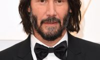 """(FILES) In this file phot US actor Keanu Reeves arrives for the 92nd Oscars at the Dolby Theatre in Hollywood, California on February 9, 2020. - Featuring a young Keanu Reeves, a madcap time-travelling plot and a supply of the most bodacious catchphrases, 1989's """"Bill & Ted's Excellent Adventure"""" has become a cult comedy classic. Three decades on, the hit that launched Reeves' career is back for a third movie -- and its air-headed, good-natured heroes' message to """"be excellent to each other"""" is needed now more than ever, its creators told AFP.""""It's certainly fortuitous,"""" co-writer Chris Matheson said ahead of the August 28, 2020 release of """"Bill & Ted Face the Music."""" (Photo by Robyn Beck / AFP)"""