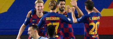 Barcelona clasificó a cuartos de final de la Champions League, al imponerse en el global 4-2 al Nápoles. Foto Prensa Libre: AFP