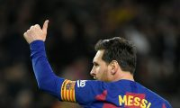 """(FILES) In this file photo taken on March 07, 2020, Barcelona's Argentine forward Lionel Messi celebrates after scoring a goal during the Spanish league football match between FC Barcelona and Real Sociedad at the Camp Nou stadium in Barcelona, Spain. - Lionel Messi said on September 4, 2020 that he will stay at Barcelona, insisting he could never go to court against """"the club of his life"""". (Photo by LLUIS GENE / AFP)"""