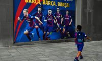 "A boy dressed up in FC Barcelona's football kit looks at a poster depicting (L to R) Barcelona's Dutch midfielder Frenkie De Jong, Barcelona's Spanish defender Gerard Pique, Barcelona's Argentinian forward Lionel Messi, Barcelona's Spanish midfielder Sergio Busquets and Barcelona's Spanish defender Sergi Roberto outside the Camp Nou stadium in Barcelona on September 4, 2020. - Lionel Messi confirmed today he will stay at Barcelona, insisting he could never go to court against ""the club of his life"". Messi released a statement at 6pm CET, saying ""I would never go to court against Barca because it is the club that I love, that gave me everything since I arrived, it is the club of my life, I have made my life here."" (Photo by Pau BARRENA / AFP)"