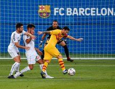 El argentino Lionel Messi  en una de las acciones del partido del Barcelona frente al Gimnastic de Tarragona. (Foto Prensa Libre: AFP).