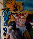 Un guardia penitenciario captado frente a un mural de la prisión de Quezaltepeque, El Salvador. (Foto Prensa Libre: AFP)
