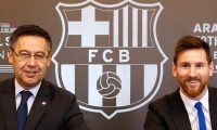 """(FILES) This handout photo taken on November 25, 2017 in Barcelona and released by the Barcelona FC press office, shows Barcelona FC President Josep Maria Bartomeu (L) and Barcelona's Argentinian forward Lionel Messi signing a contract extension keeping Messi at Barcelona until 2021. - Six-time Ballon d'Or winner Lionel Messi told Barcelona he wants to leave -- on a free transfer -- in a """"bombshell"""" fax yesterday that is expected to spark a legal battle over a buy-out clause worth hundreds of millions of dollars. (Photo by Handout / FC BARCELONA / AFP) / RESTRICTED TO EDITORIAL USE - MANDATORY CREDIT """"AFP PHOTO / FC BARCELONA"""" - NO MARKETING - NO ADVERTISING CAMPAIGNS - DISTRIBUTED AS A SERVICE TO CLIENTS"""