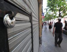 Por varios meses, comercios y empresas debieron cerrar o trabajar por menos personal, antes restricciones por el coronavirus. (Foto, Prensa Libre: Hemeroteca PL).