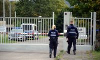 Traben-trarbach (Germany).- (FILE) - Policemen walk in front of the entrance gate to a former NATO bunker (not visible), where searches on the occasion of an illegal computer center was discovered, in Traben-Trarbach, Germany, 28 September 2019 (reissued 19 October 2020). A Dutch operator of a data center in a bunker facility in Traben-Trarbach is standing trial at the Trier Regional Court over alleged cyber crimes. Some 249,000 crimes are said to have been carried out via the cyberbunker's servers, according to the prosecutor. (Alemania) EFE/EPA/HARALD TITTEL *** Local Caption *** 55502192