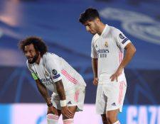 Los jugadores del Real Madrid, Marcelo Vieira (i) y Marco Asensio durante el partido ante el Shakhtar. (Foto Prensa Libre: EFE)