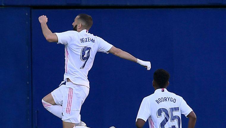 Al minuto 90-5 Karim Benzema cerró el marcador que Vinícius Júnior había abierto a favor del Real Madrid. (Foto Prensa Libre: AFP)