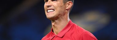 (FILES) In this file photo taken on September 08, 2020 Portugal's forward Cristiano Ronaldo reacts after scoring his second goal during the UEFA Nations League football match between Sweden and Portugal on September 8, 2020 in Solna, Sweden. - Cristiano Ronaldo has tested positive for Covid-19, the Portuguese Football Federation announced on October 13, 2020. (Photo by Jonathan NACKSTRAND / AFP)