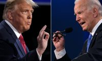 (COMBO) This combination of pictures created on October 22, 2020 shows US President Donald Trump (L) and Democratic Presidential candidate and former US Vice President Joe Biden during the final presidential debate at Belmont University in Nashville, Tennessee, on October 22, 2020. (Photos by Brendan Smialowski and JIM WATSON / AFP)