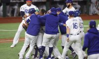 (FILES) In this file photo the Los Angeles Dodgers celebrate after defeating the Tampa Bay Rays in Game Six to win the 2020 MLB World Series at Globe Life Field on October 27, 2020 in Arlington, Texas. - The Los Angeles Dodgers ended their 32-year wait for a World Series title on October 27, 2020, beating the Tampa Bay Rays 3-1 to claim the Major League Baseball crown at last after a string of agonizing near-misses.Corey Seager drove in the go-ahead run, Mookie Betts homered late and a stream of Los Angeles pitchers stood firm as the Dodgers won the seventh World Series in club history but their first since 1988. (Photo by TOM PENNINGTON / GETTY IMAGES NORTH AMERICA / AFP)