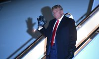 US President Donald Trump waves as he steps off Air Force One upon arrival at Andrews Air Force Base in Maryland on October 30, 2020. - The President returns after a campaign rally at Rochester International Airport in Rochester, Minnesota. (Photo by MANDEL NGAN / AFP)