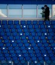 A man walks between the empty seats ahead of the Italian Serie A football match between Lazio (SSL) and Juventus (JFC) , at the Olympic stadium in Rome on November 8, 2020. (Photo by Filippo MONTEFORTE / AFP)