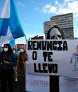 Los manifestantes participan en una protesta exigiendo la renuncia del presidente guatemalteco Alejandro Giammattei, en la Ciudad de Guatemala el 28 de noviembre de 2020. (Foto Prensa Libre: AFP)