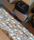 Operativo para contabilizar el dinero localizado en Antigua Guatemala demoró dos días. (Foto Prensa Libre: MP)