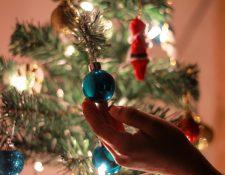 Foto Principal: La decoración navideña refleja la personalidad y entusiasmo por las fiestas de fin de año, según los expertos. (Foto Prensa Libre: Aswathy N on Unsplash).