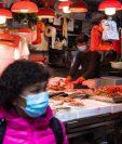 Científicos creen que el origen del coronavirus es zoonótico y que el mercado de Huanan, en Wuhan, es la clave para descubrirlo. (Foto Prensa Libre: AFP)