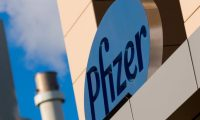 (FILES) In this file photo taken on March 18, 2017, a sign for Pfizer pharmaceutical company is seen on a building in Cambridge, Massachusetts. - Pfizer reported lower third-quarter profits on October 27, 2020 as Covid-19 dented demand for some medicines from patients whose regular health care patterns were disrupted. The drugmaker, which is working on clinical trials for a coronavirus vaccine, reported a 71 percent drop in profit to $2.2 billion. The year-ago period included a large gain connected to a transaction. (Photo by DOMINICK REUTER / AFP)