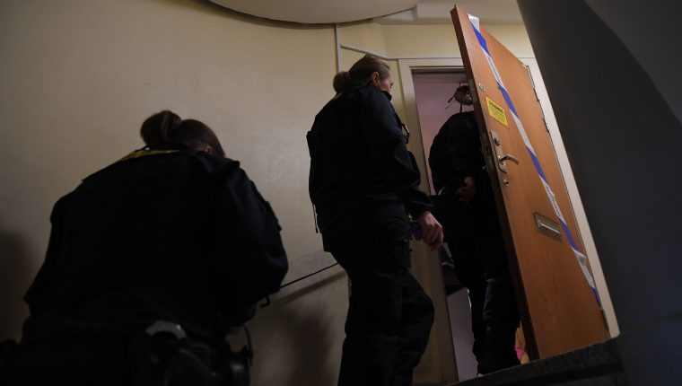 Police technicians enter an apartment in Haninge, south of Stockholm, on December 1, 2020, one day after a man in his 40s who was kept locked by his mother was found there. - A mother in Sweden has been arrested on suspicion of locking her son inside their apartment for 28 years, leaving him undernourished and with almost no teeth, police and media reports said. (Photo by Jonathan NACKSTRAND / AFP)