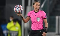 French referee Stephanie Frappart holds the ball as she prepares to blow the kick off during the UEFA Champions League Group G football match Juventus vs Dynamo Kiev on December 2, 2020 at the Juventus stadium in Turin. (Photo by Vincenzo PINTO / AFP)