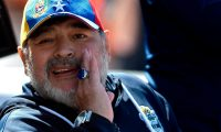 (FILES) In this file photo taken on October 5, 2019 Gimnasia y Esgrima team coach Argentinian former football star Diego Armando Maradona gestures during an Argentina First Division Superliga football match against Godoy Cruz at Malvinas Argentinas stadium in Mendoza, Argentina. - Diego Maradona, one of the greatest footballers of all time, died on November 25, 2020 at the age of 60. (Photo by Andres Larrovere / AFP)