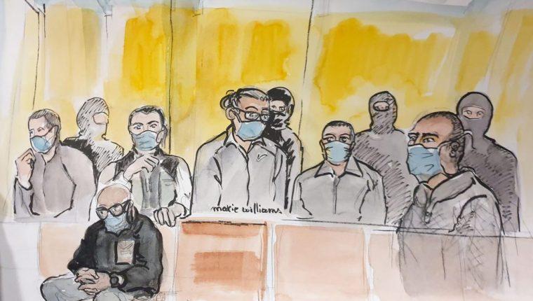 Ali Riza Polat (der), uno de los implicados directos en el ataque, escucha la sentencia. (Foto Prensa Libre: AFP)