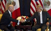 (FILES) In this file picture taken on March 5, 2012 then US Vice-President Joe Biden (L) shakes hands with then Mexican presidential candidate for Democratic Revolution Party (PRD) Andres Manuel Lopez Obrador (R), during a meeting in Mexico City. - Mexican President Andres Manuel Lopez Obrador said on December 21, 2020 he expects US President-elect Joe Biden to help stem the wave of migration from Central America through investment. (Photo by Yuri CORTEZ / AFP)