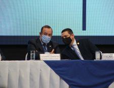 El presidente Alejandro Giammattei y el comisionado Oscar Dávila durante una actividad en el Día internacional contra la Corrupción, el 9 de diciembre. (Foto Prensa Libre: Hemeroteca PL)