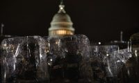 WASHINGTON, DC - JANUARY 06: Members of the National Guard and the Washington D.C. police stand guard to keep demonstrators away from the U.S. Capitol on January 06, 2021 in Washington, DC. A pro-Trump mob stormed the Capitol earlier, breaking windows and clashing with police officers. Trump supporters gathered in the nation's capital to protest the ratification of President-elect Joe Biden's Electoral College victory over President Donald Trump in the 2020 election.   Samuel Corum/Getty Images/AFP == FOR NEWSPAPERS, INTERNET, TELCOS & TELEVISION USE ONLY ==