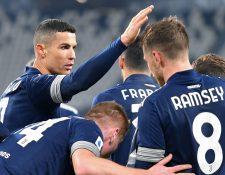Cristiano Ronaldo, Aaron Ramsey y Danilo fueron los anotadores del triunfo de la Juventus por 3-1 sobre el Sassuolo. (Foto Prensa Libre: EFE)