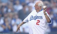 FILES) In this file photo former Los Angeles Dodgers player and manager Tommy Lasorda throws the ceremonial first pitch prior to Game Three of the 2018 World Series between the Los Angeles Dodgers and the Boston Red Sox at Dodger Stadium on October 26, 2018 in Los Angeles. - Former Los Angeles Dodgers manager Tommy Lasorda has died after suffering a heart attack at his home, the Dodgers said January 8, 2021. He was 93. Lasorda, who had only returned to his home on Tuesday after a long hospital stay for an undisclosed illness, passed away late Thursday, the Dodgers said. (Photo by EZRA SHAW / GETTY IMAGES NORTH AMERICA / AFP)