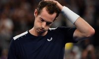 (FILES) In this file photograph taken on January 14, 2019, Britain's Andy Murray reacts after defeat in his men's singles match against Spain's Roberto Bautista Agut on day one of the Australian Open tennis tournament in Melbourne. - Andy Murray's participation in the Australian Open is in doubt after it was announced on January 14, 2021, that he had tested positive for coronavirus. The former world number one was due to travel to Australia on one of a series of charter flights laid on by tournament organisers but is still isolating at home in London. (Photo by SAEED KHAN / AFP) / -- IMAGE RESTRICTED TO EDITORIAL USE - STRICTLY NO COMMERCIAL USE --