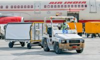 An Air India flight carrying doses of the Covishield vaccine manufactured in India is seen after its arrival at the Velana International Airport, in Male on January 20, 2021. - India exported its first batch of locally produced coronavirus shots on January 20, officials said, as the world's biggest vaccine manufacturer scrambled to meet requests from other countries desperate to protect their populations. (Photo by - / AFP)
