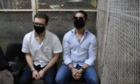 Luis Enrique Martinelli (R) and Ricardo Martinelli Jr., sons of Panamanian former president (2009-2014) Ricardo Martinelli, remain handcuffed after being arrested in Guatemala City, on July 6, 2020. - The arrest comes after the lawyer of Panama's former president Ricardo Martinelli said he must face corruption charges, just eight months after he was acquitted of spying on political foes. (Photo by Johan ORDONEZ / AFP)