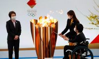 Naraha (Japan), 24/03/2021.- Tokyo 2020 Organising Committee President Seiko Hashimoto (L) looks on as actor Satomi Hishihara (R,back) and Paralyimpian Aki Taguchi light the celebration cauldron on the first day of the Tokyo 2020 Olympic torch relay in Naraha, Fukushima prefecture, Japan, 25 March 2021. (Japón, Tokio) EFE/EPA/KIM KYUNG-HOON / POOL