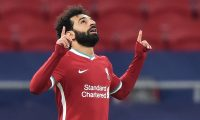 Liverpool's Egyptian midfielder Mohamed Salah celebrates scoring his team's first goal during the UEFA Champions league Last 16 2nd Leg football match between Liverpool and RB Leipzig at Puskas Arena in Budapest, Hungary, on March 10, 2021. (Photo by Attila KISBENEDEK / AFP)