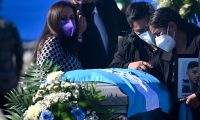 Relatives mourn next to the coffin with the remain of a Guatemalan migrant who was found murdered in the northern state of Tamaulipas last month, upon arrival at the Air Force base, in Guatemala City on March 12, 2021. - On January 22, 19 charred bodies were found in Tamaulipas, a state on the border with the United States that has been rocked for years by organized crime gangs. Sixteen of the dead were determined to be Guatemalan and the other three of Mexican origin. (Photo by Johan ORDONEZ / AFP)