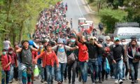 Honduran migrants is seen at Camotan in Guatemala forming the first migrant caravan of the year on it's way to the United States on January 16, 2021. - Some 3,000 people left Honduras on foot January 15 in the latest migrant caravan hoping to find a welcome, and a better life, in the US under President-elect Joe Biden. Seeking to escape poverty, unemployment, gang and drug violence and the aftermath of two devastating hurricanes, the migrants plan to walk thousands of kilometers through Central America. (Photo by Johan ORDONEZ / AFP)